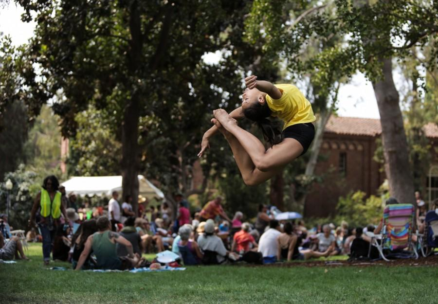 Kimly Lewis, 15, performs a ring flip in front of Kendall Hall during Chico World Music Festival. Photo credit: Emily Teague