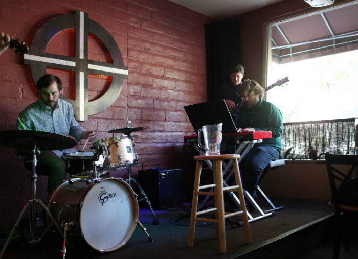 Jazz group Bogg, made up of Michael Bones on drums, Gavin Fitzgerald on bass and Josh Hegg on the keyboard, performed for customers at Cafe Coda on Friday morning. Photo credit: John Domogma