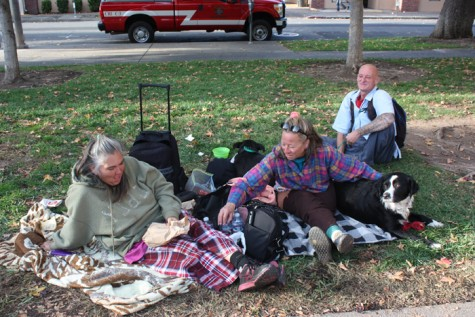 From left: Tina, Charles and Chiquita relax on their blankets as the sun sets in City Plaza. Photo credit: Allisun Coote
