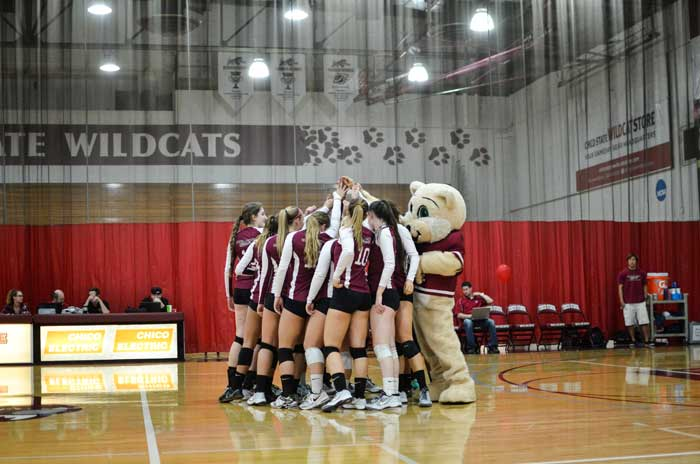 The Chico State volleyball team circles up to get pumped up before a match. Photo credit: Ryan Pressey
