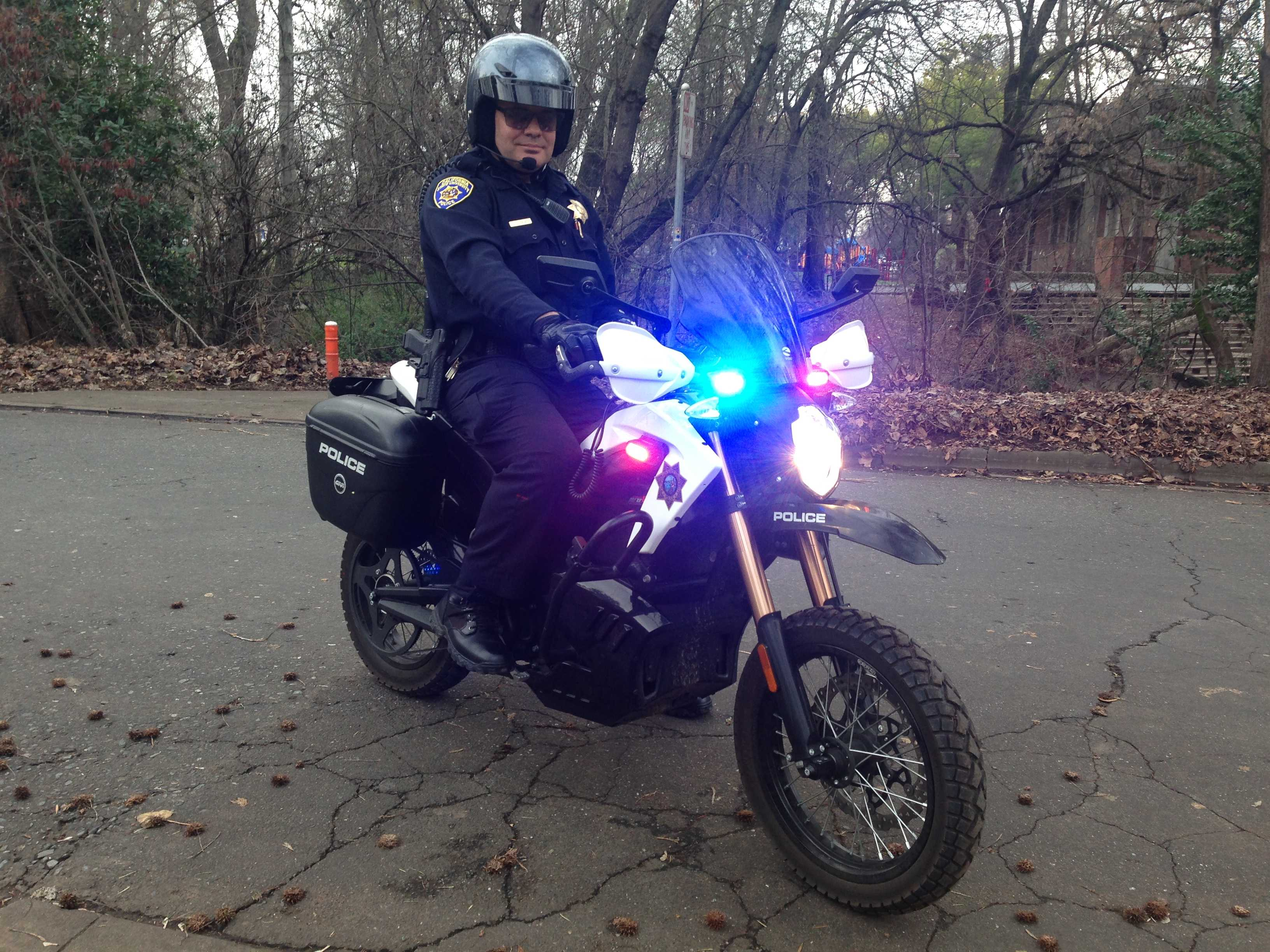 University Police Officer Lance Conlan flashes the lights on an electric motorcycle borrowed from San Jose State. Photo credit: Gabriel Sandoval