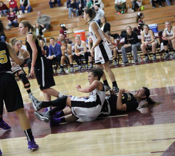 Sophomore+guard+Whitney+Branham+fights+for+possession+of+the+ball+on+the+ground.+Photo+credit%3A+George+Johnston