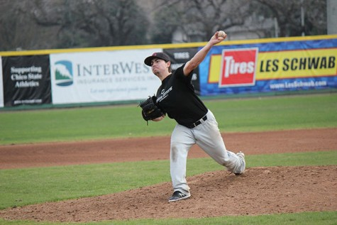Senior pitcher AJ Epstein pitches the ball during a scrimmage on Jan. 21. Photo credit: Lindsay Pincus
