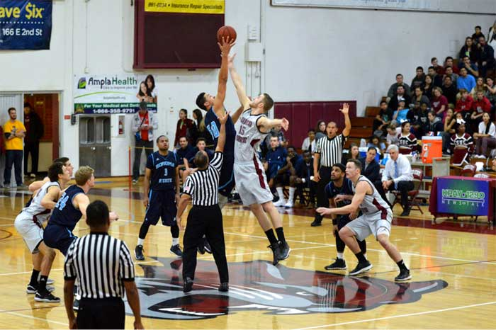 Senior center Tanner Giddings jumps for the opening tip. Photo credit: Caio Calado