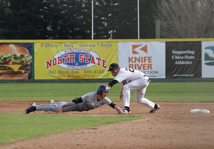 Junior shortstop Casey Bennett tags out a runner during a game against Menlo College on Jan. 31. Photo credit: Jacob Auby