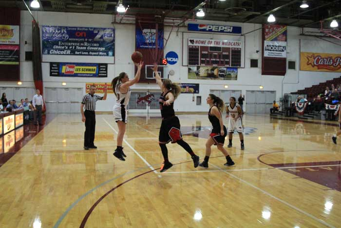 Senior Brooke Bowen shoots a contested shot against Simpson University on Jan. 23. Photo credit: Cam Lesslie