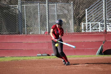 Senior Alli Cook swings at the ball during practice on Jan. 27. Photo credit: Lindsay Pincus
