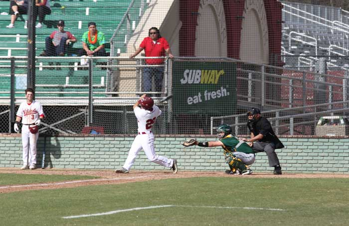 Junior outfielder Sonny Cortez takes a rip in a game against Point Loma on Feb. 6. Photo credit: Allisun Coote