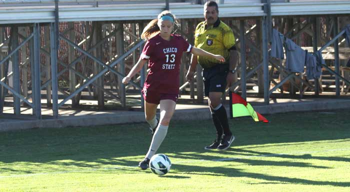Junior Lindsey Dias winds up to kick the ball in a game last semester. Photo credit: Allisun Coote