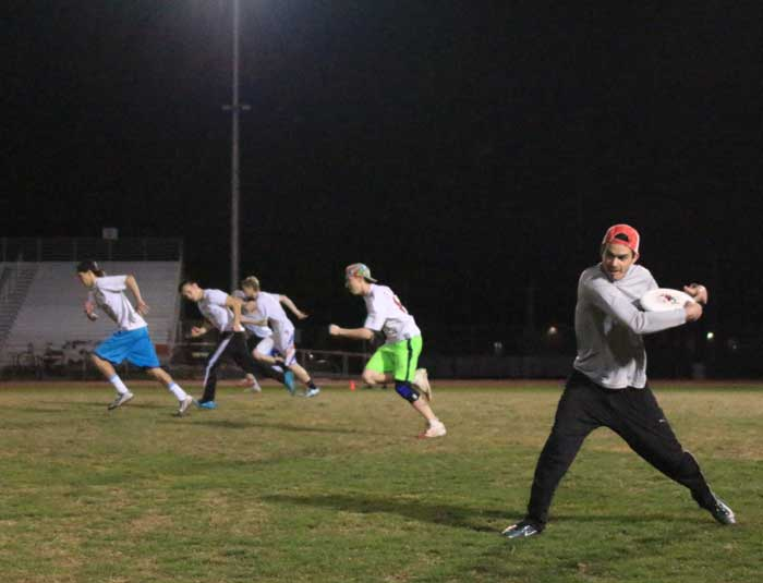 Senior Grant Manley winds up to throw the frisbee during a practice on Feb. 9. Photo credit: Cam Lesslie