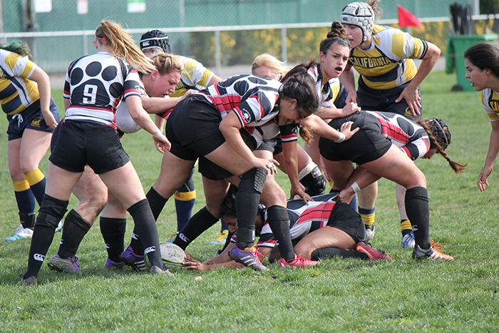 The+Chico+State+women%27s+rugby+team+protects+the+ball+in+a+game+on+Feb.+20.+