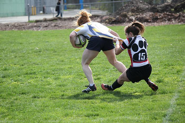 Sophomore Darby McFall drags down her opponent in a game on Feb. 20.