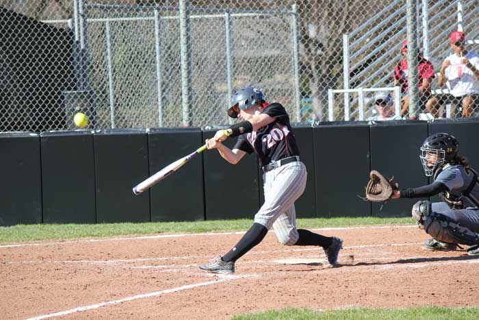 Senior Brynn Lesovsky swings at the ball during the game against Dominican University on Feb. 7. Photo credit: Lindsay Pincus