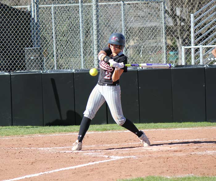 First-year+Ari+Marsh+hits+the+ball+at+the+game+against+Dominican+University+on+Feb.+7.+Photo+credit%3A+Lindsay+Pincus