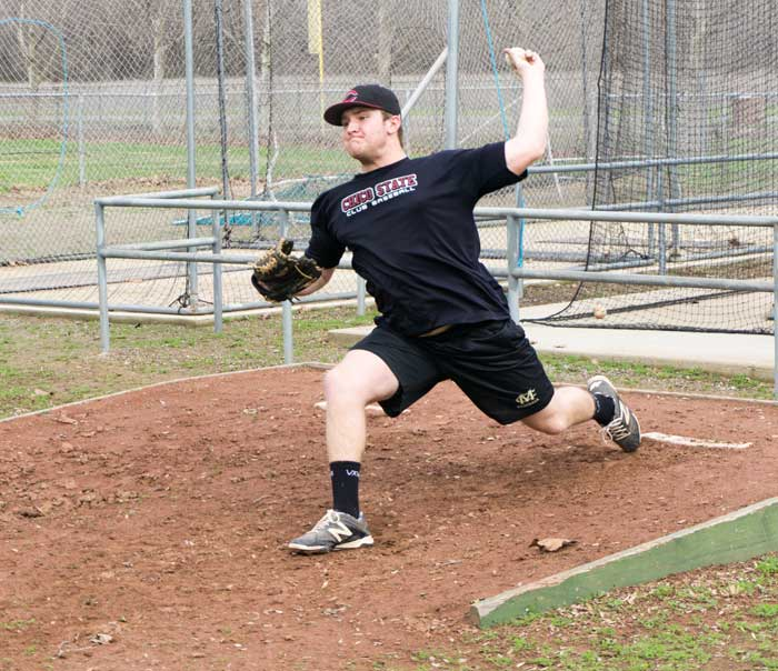 First year pitcher Zach Scott warms up before practice on Feb. 3. Photo credit: Carlos Islas