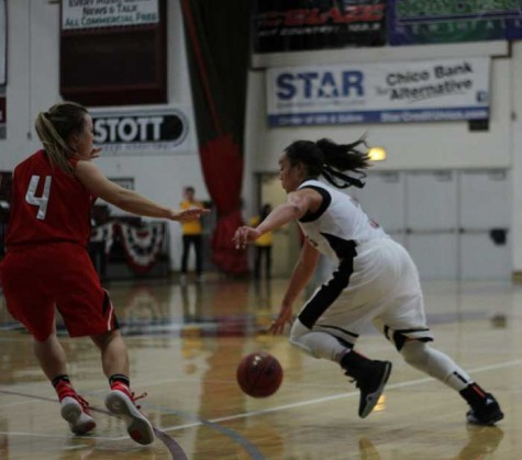 Sophomore Whitney Branham dribbles around her opponent in a game against Cal State Stanislaus. Photo credit: Jordan Olesen