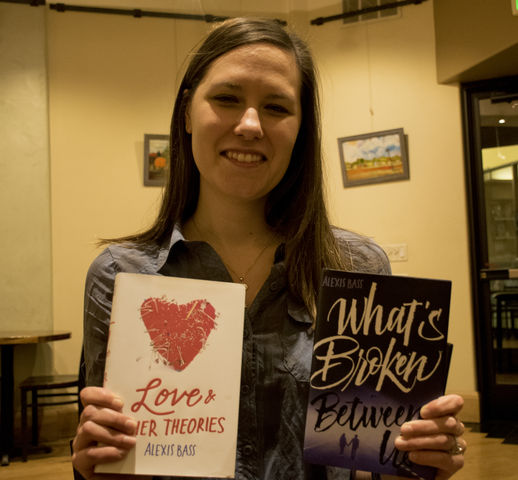 Alexis Bass, local author, shows off her books. Photo credit: Aurora Evans
