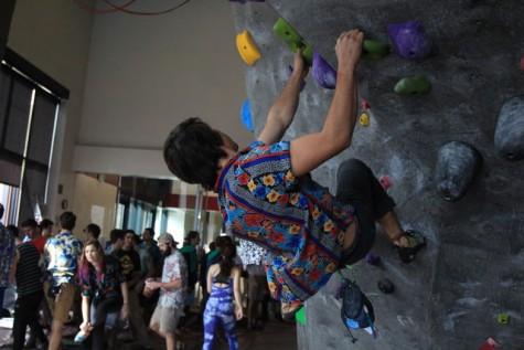 Senior Ian Colunga battles gravity during competition on Feb. 20. Photo credit: Cam Lesslie