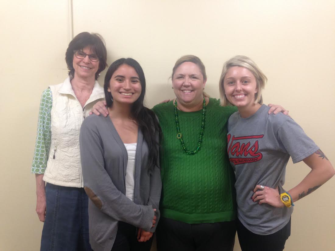 Ann, Brina, Trisha and Taylor are all smiles as they await the first day of the Mindfulness Based Stress Reduction course. Photo credit: Dominique Diaz