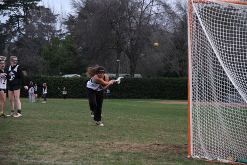 Senior Jazmin De La Cruz launches the ball toward the net during practice. Photo credit: Jacob Auby