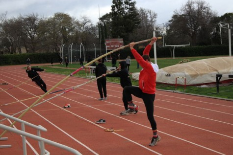 The Chico State track and field team warms up for pole vaulting practice. Photo credit: Cam Lesslie