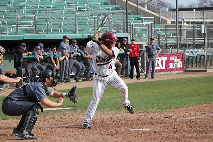 Senior shortstop Tony Roque steps into a pitch during a game against Academy of Art. Photo credit: Lindsay Pincus
