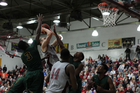 Junior Robert Duncan drives in a game against Cal Poly Pomona on Feb. 19. Photo credit: Jacob Auby