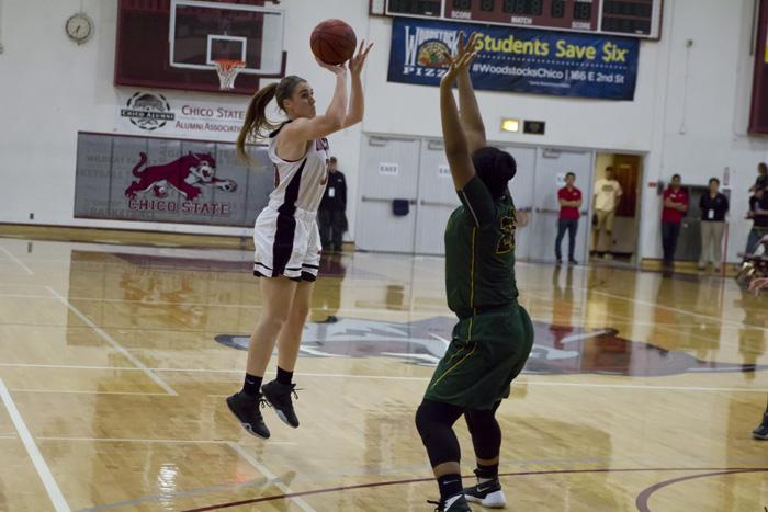 Senior Brooke Bowen elevates to take a shot over her opponent. Photo credit: Jordan Olesen