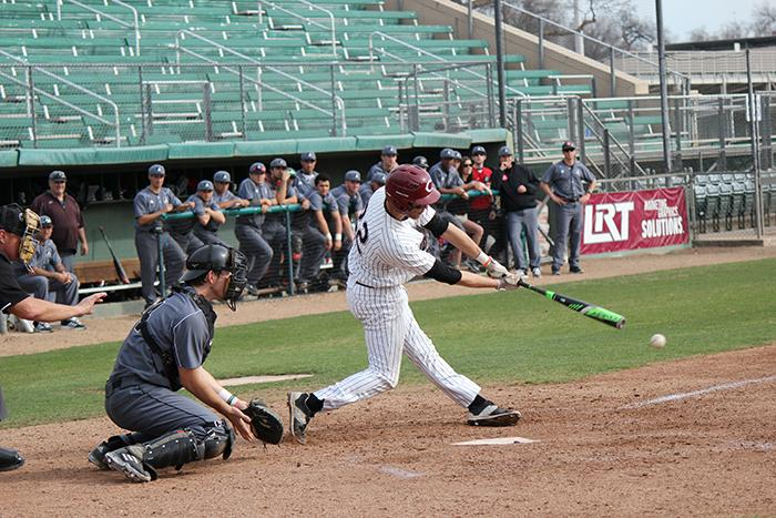 Junior infielder Casey Bennett makes contact during a game against the Academy of Art. Photo credit: Lindsay Pincus