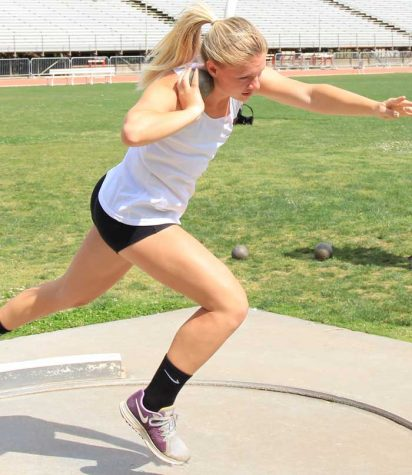 First-year Olivia Abbott winds up to launch the shot put during practice. Photo credit: Cam Lesslie