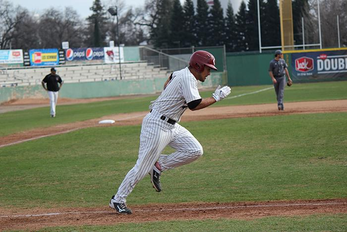 Senior Ben Gamba sprints to first base in a game against Academy of Art. Photo credit: Nick Martinez-Esquibel