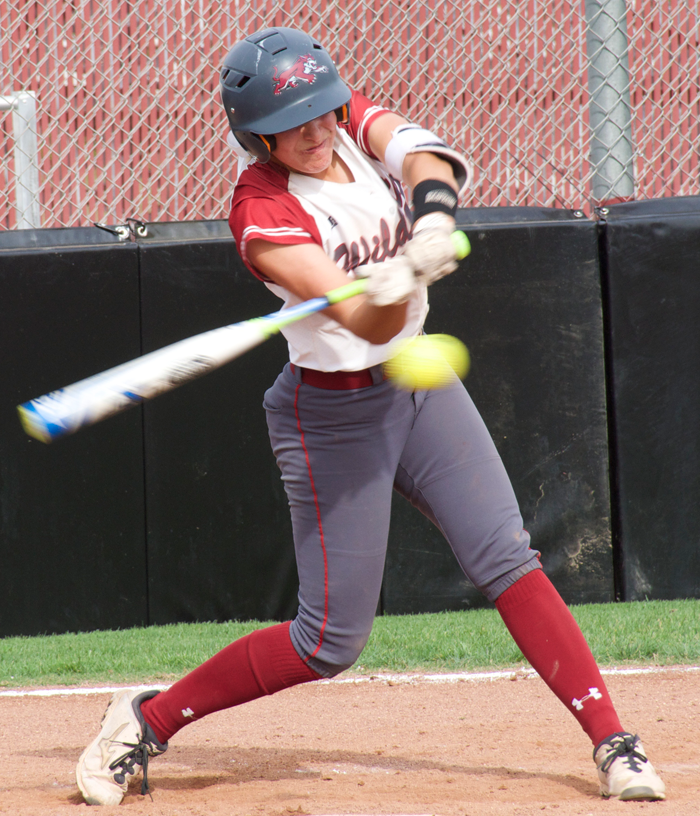 First-year Rachel DeHart swings at a ball during a game against Cal State Dominguez Hills. Photo credit: Nick Martinez-Esquibel