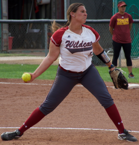 Softball pitcher launches first career home run in win