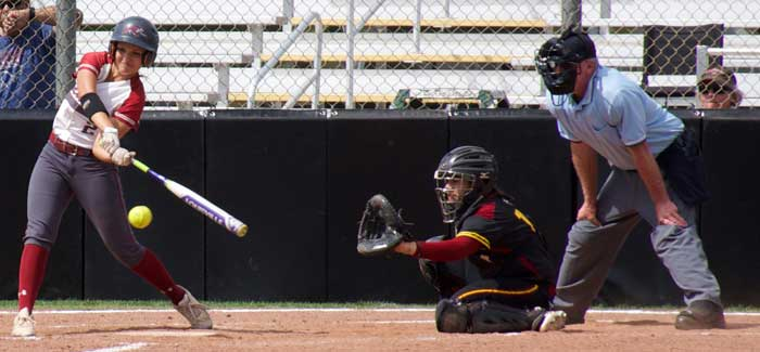 First-year Ari Marsh swings at the ball in a game against Cal State Dominguez Hills. Photo credit: Nick Martinez-Esquibel