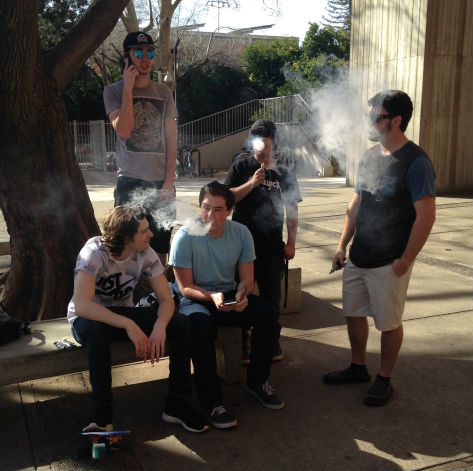 Chico State students smoke outside of Whitney Hall. Photo credit: Amelia Storm