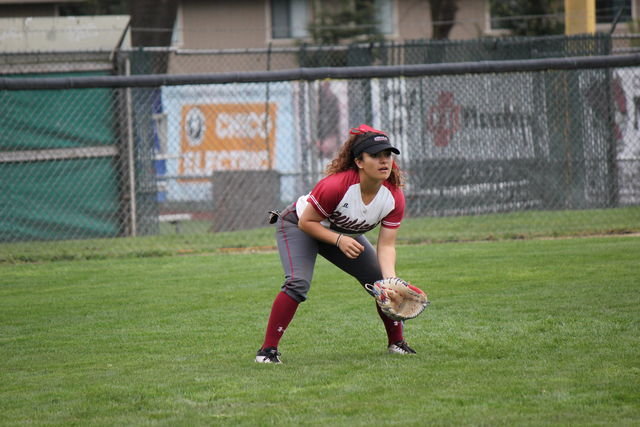Junior Sarah Galviz waits for the play in the outfield. Photo credit: Lindsay Pincus