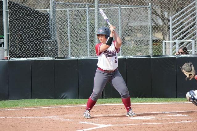 Junior Cyrena Taylor waits patiently for the pitcher to deliver the ball. Photo credit: Lindsay Pincus