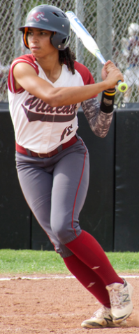 Junior Cailin Garmon leans toward first base during her at bat in a game against Cal State Dominguez Hills. Photo credit: Nick Martinez-Esquibel