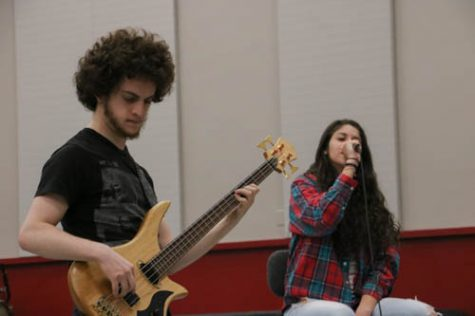 Bass player Aron Linker jams out during rehearsal. Photo credit: Megan Moran