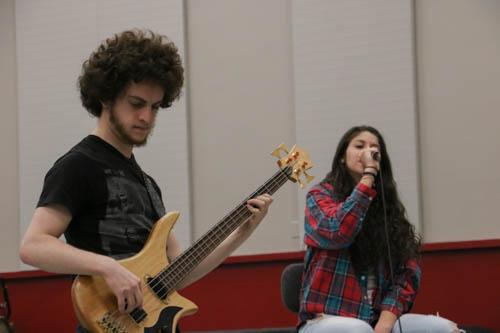 Bass player Aron Linker jams out during rehearsal. Photo credit: Megan Moran
