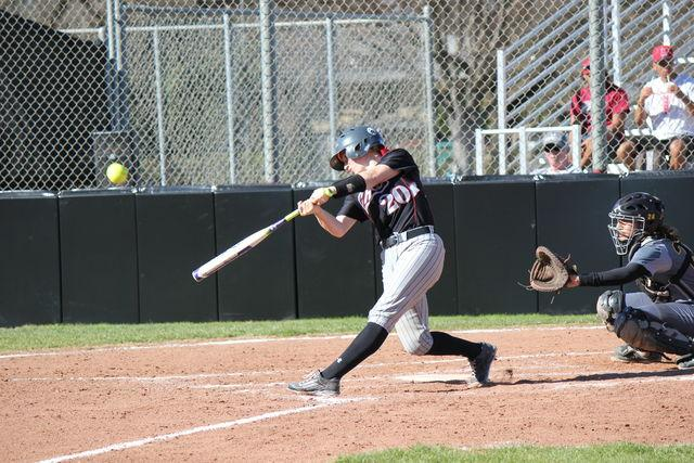 Senior+catcher+Brynn+Lesovsky+launches+the+ball+off+her+bat+during+a+game.+Photo+credit%3A+Lindsay+Pincus
