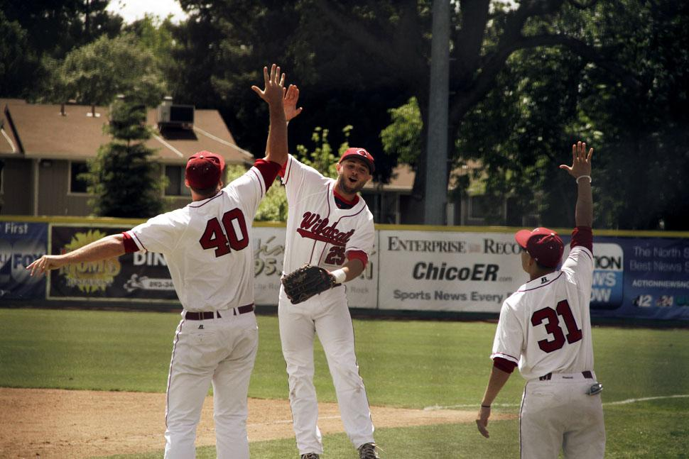 Junior Cody Snider jumps up for a high-five with teammate junior Dalton Erb as senior Andrew Carrillo watches. Photo credit: Jacob Auby
