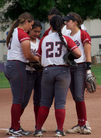 The Chico State softball team talks between innings in a game against Cal State Dominguez Hills. Photo credit: Nick Martinez-Esquibel