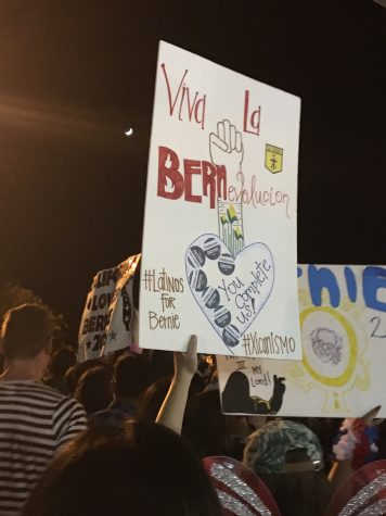 Bernie Sanders supporters show support of their candidate with posters. Photo credit: Amelia Storm