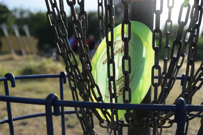 A driver disc sits in the chains of the target. Photo credit: Nick Martinez-Esquibel
