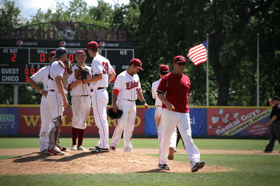 Head coach Dave Taylor walks off the mound after talking with his team. Photo credit: Jacob Auby