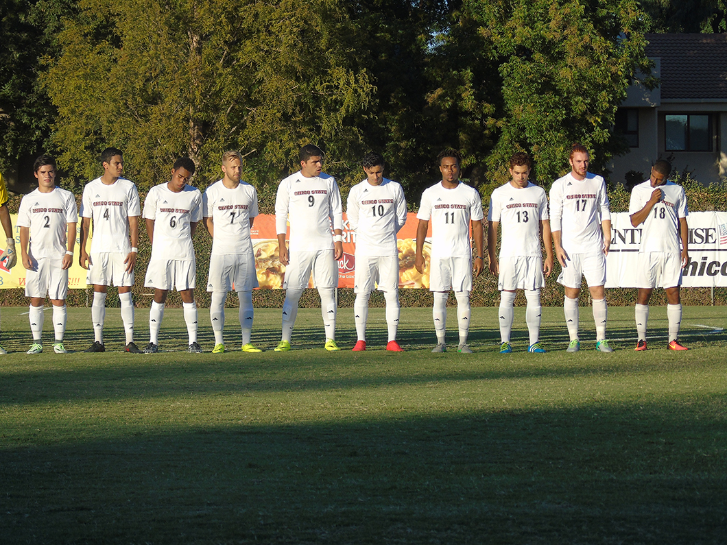 The men's soccer team lines up before their game Photo credit: Royal T Lee-Castine