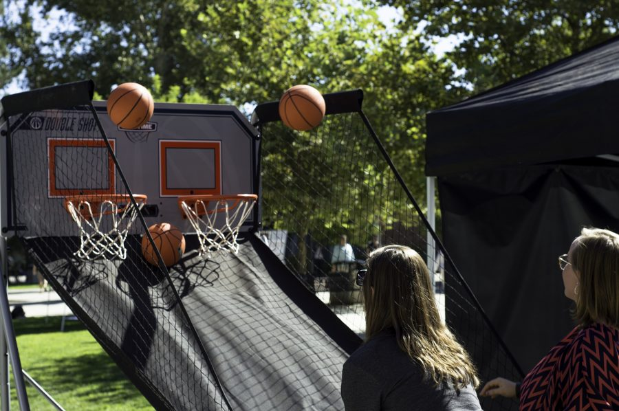 Aug. 24 - Students representing the Chico State Christian Challenge tent, duel in a little bit of arcade basketball.