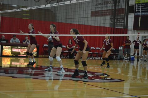 The Chico State women's volleyball team prepares for a serve during their home game. Photo credit: Jordan Jarrell