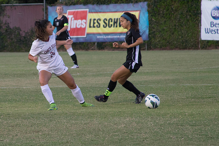 First-year forward Sarah Yang attempts a slide tackle during a 'Cats home game. Photo credit: Aubrie Coley